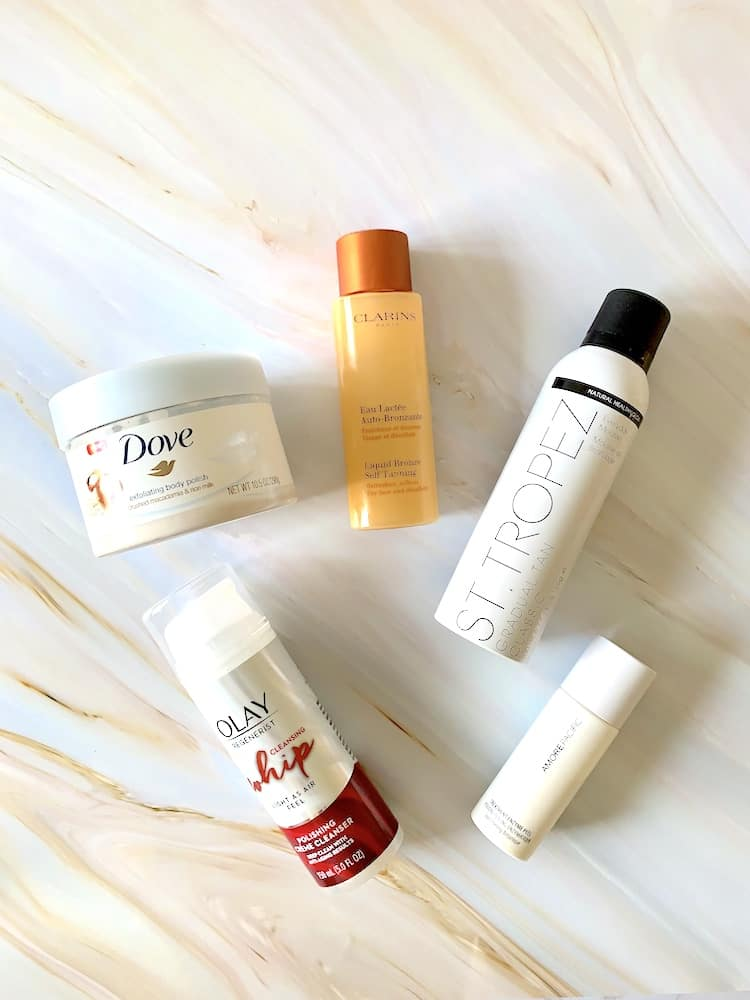 Self Tanning Products - Clarins Liquid Bronze, St Tropez Gradual Tan Classic Mousse, Dove Body Polish, Olay Whip Polishing Cleanser, Amore Pacific Treatment Enzyme Peel