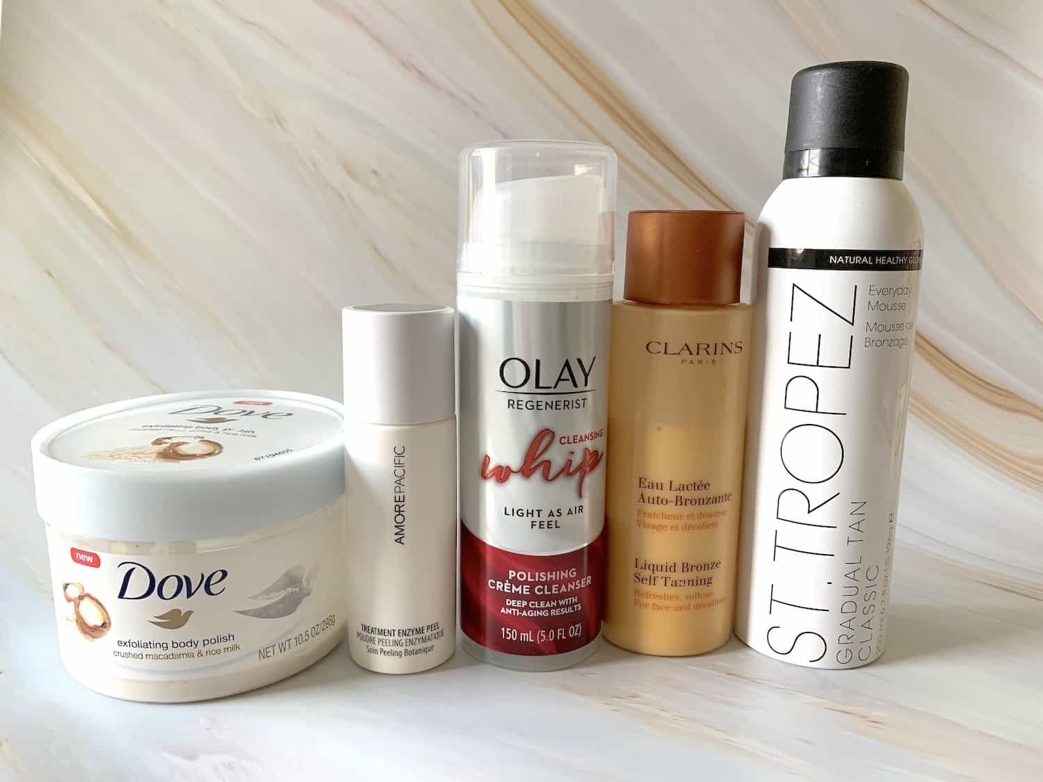 Self Tanning Products - Clarins Liquid Bronze, St Tropez Gradual Tan Classic Mousse, Dove Body Polish, Loreal Sublim Bronze Self Tanning Towelettes, Olay Whip Polishing Cleanser, Amore Pacific Treatment Enzyme Peel