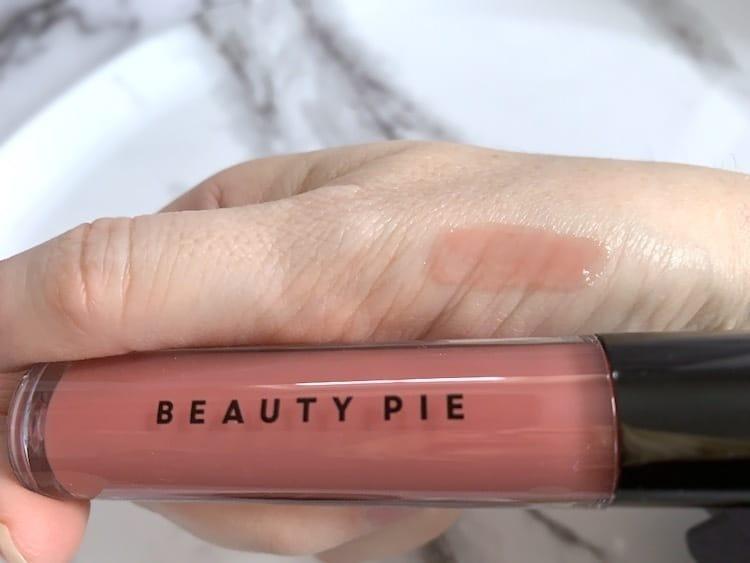 Beauty Pie Wondergloss Lip Oil Sampled on Hand