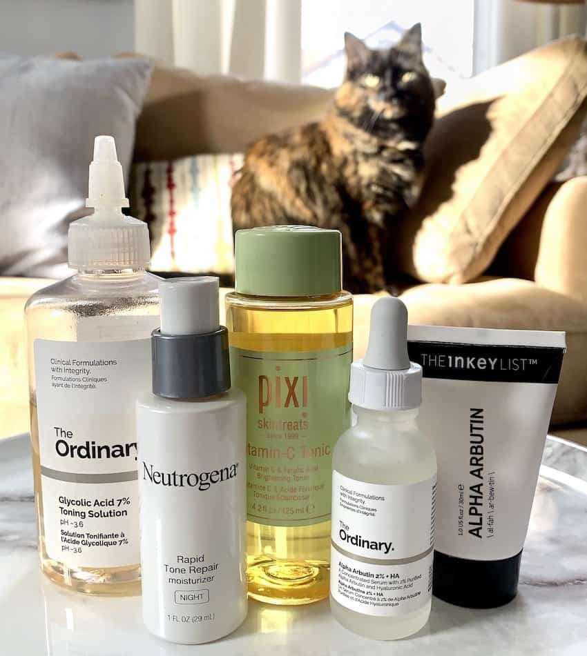 Hyperpigmentation Skincare Products in front of Sweet Pea the Cat
