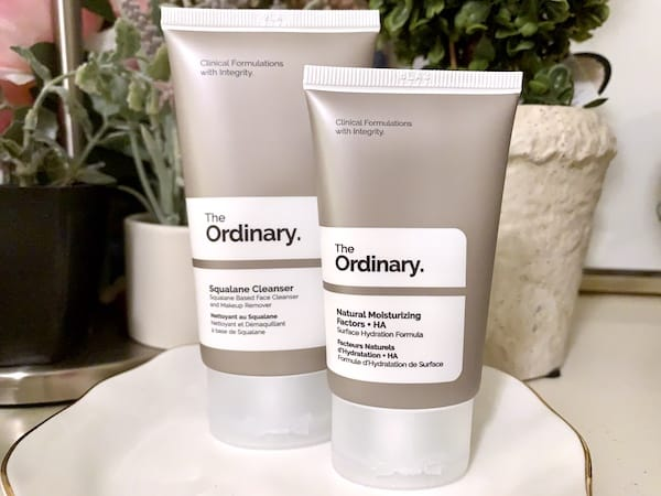 The Ordinary Squalane Cleanser and Natueral Moisturizing Factors + HA on dish