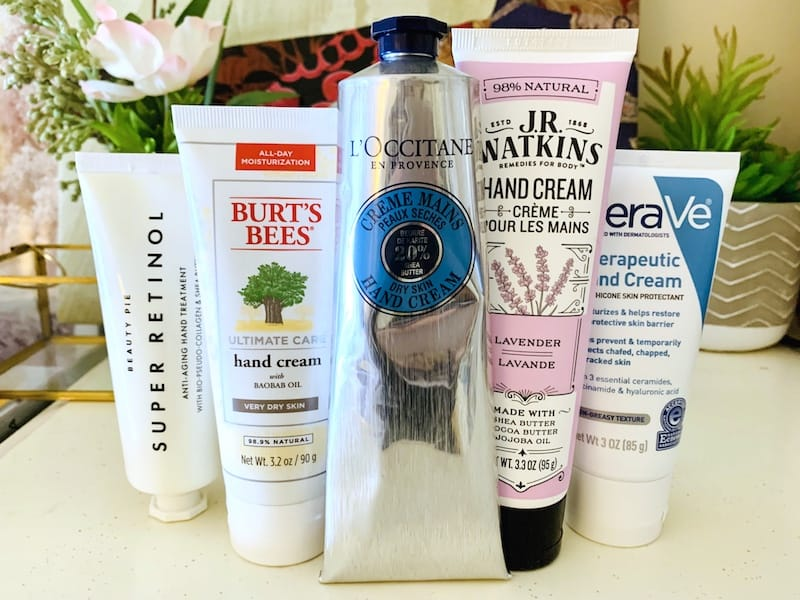 Drugstore and Luxury Hand Creams for Dry Skin in front of Flowers