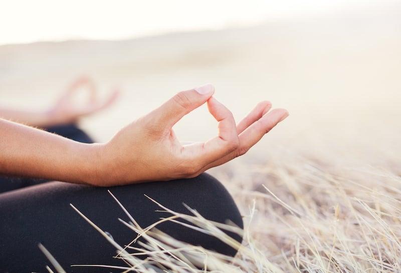 Woman Cross-Legged Meditating Outdoors
