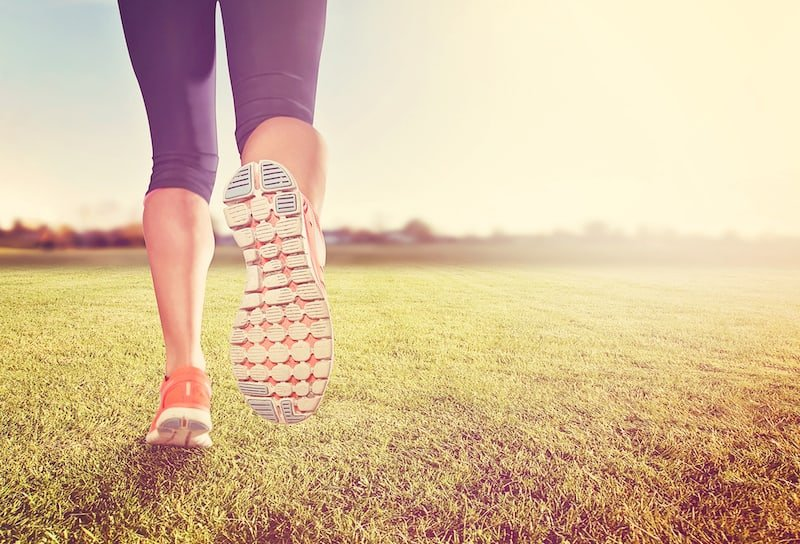 Woman Exercising/Running on Grass