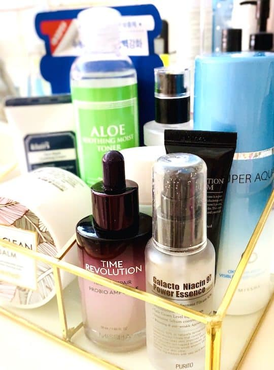The 10 Step Korean Skincare Routine Products in Glass Container