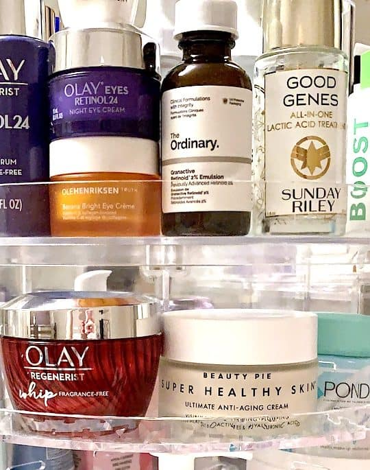 skincare creams cleansers and serums on circular organizer