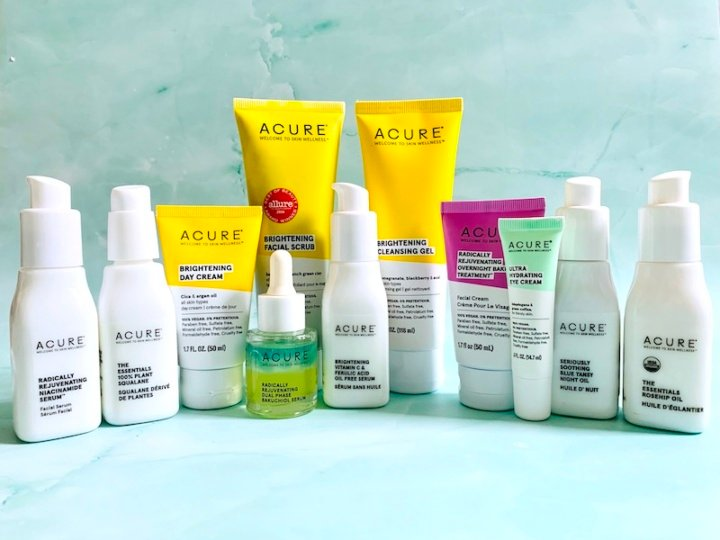 Acure Organics Skincare Review - Products on a Green Background